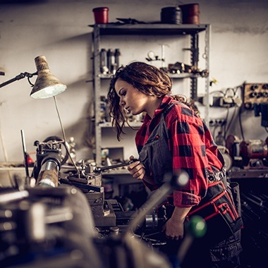 Young Woman in Machine Shop